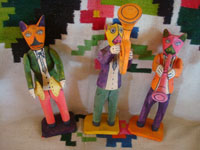 Mexican vintage folk art, and Mexican vintage woodcarvings and masks, a wonderful wood-carved set of three lively musicians, playing their little hearts out, San Martin Tejalapa, Oaxaca, c. 1950's. Main photo of the musicians.