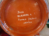 Mexican vintage pottery and ceramics, a beautiful lidded jar with very fine petatillo cross-hatching in the background and wonderful artwork, signed Jose Bernabe, Tonala, Jalisco, c. 1940's.  Photo of the bottom of the jar showing Bernabe's signature.
