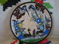 Mexican vintage pottery and ceramics, a very lovely pair of pottery plates with a fine petatillo cross-hatched background and very beautiful artwork, by Tomas Lucano, Tonala or San Pedro Tlaquepaque, Jalisco, c. 1930's.  Closeup photo of the front of one of the plates by Tomas Lucano.