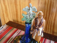 Mexican vintage folk art, and Mexican vintage pottery and ceramics, a wonderful pottery sculpture depicting Padre Miguel Hidalgo, the father of the Mexican revolution of 1810, Oaxaca, c. 1930's.  A side-view of the sculpture.
