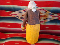 Navajo wood carving of elderly woman, view of back.