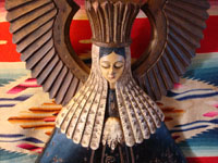 Closeup photo of the wood carving of Our Lady of the Soledad