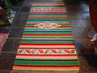 Mexican vintage textile, Saltillo sarape with green background, c. 1940.