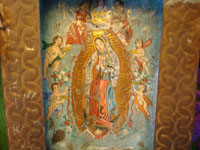 Closeup of Mexican tinwork nicho with Our Lady of Guadalupe