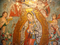 Another closeup of Mexican tinwork nicho showing closeup of Our Lady of Guadalupe