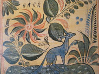Closeup photo of Mexican tile with blue fox.