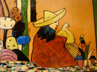 Closeup of tile with Mexican ranch scene.