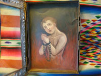 Closeup of retablo of soul in purgatoryl.