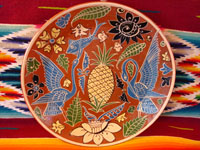 Mexican vintage pottery, Fantasia-style plate with central pineapple, Tlaquepaque, Jalisco, c. 1930.