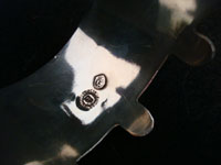 Closeup photo of Taxco silver cuff showing eagle mark with number.