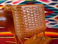Closeup photo of wood burro, showing details of the basket.