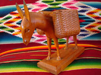 Closeup photo of one of the wooden burros.
