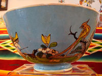 Mexican vintage pottery, Tlaquepaque bowl, closeup photo of side designs, floral with peasant and bird.