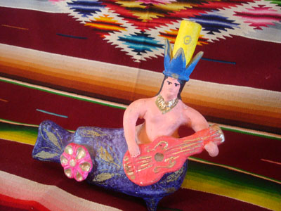 Mexican vintage folk art, and Mexican vintage pottery and ceramics, a whimsical and lovely pottery mermaid with a guitar and wonderfully decorated, Metepec, c. 1950.