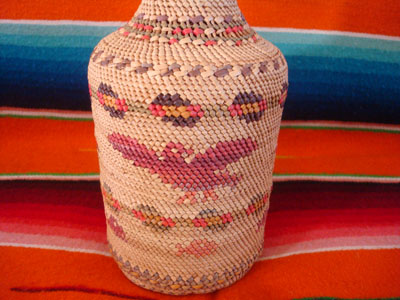 Native American Indian vintage basketry and weaving, a wonderful basketry covered bottle, Makah, Washington state, c. 1940. The weaving features wonderful images of eagles and fish. A closeup photo showing a wonderful eagle.