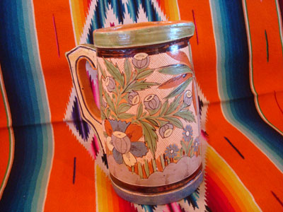 Mexican vintage pottery and ceramics, a beautiful petatillo (cross-hatching in the background, resembling a straw mat or petate, in Spanish) pottery pitcher, with beautiful and intricate decorations, Tonala or San Pedro Tlaquepaque, c. 1930's.