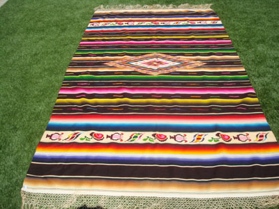 Mexican vintage textiles and Saltillo serapes (sarapes), a beautiful Saltillo serape with a rich, dark-brown background and lovely rosettes on each end, Saltillo, Coahuilla, c. 1930's.
