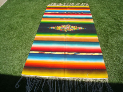 Mexican vintage textiles and Saltillo serapes (sarapes), a very beautiful Saltillo serape with a rainbow colored background and wonderful, bright colors, Saltillo, Coahuilla, c. 1940.
