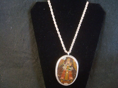 Mexican vintage devotional art, and Mexican vintage sterling silver jewelry, a beautiful rellicario with the small retablo beautifully painted on tin, with a lovely sterling silver rope chain, c. 1920's.