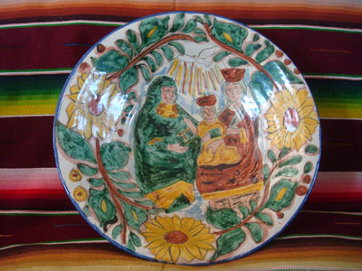 Mexican vintage pottery and ceramics, a lovely talavera bowl decorated with the image of the Baby Christ, along with his Mother, Mary, and St. Anne, the mother of Mary, Guanajuato, c. 1950's.