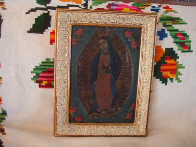 Mexican vintage devotional art, and Mexican vintage tinwork art, a beautiful retable depicting Our Lady of Guadalupe, painted on tin and framed, c. 1930.