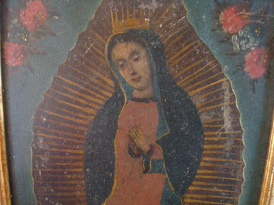 Mexican vintage devotional art, and Mexican vintage tinwork art, a beautiful retable depicting Our Lady of Guadalupe, painted on tin and framed, c. 1930. The faces of Our Lady and the angel at her feet are very serene and beautifully painted.