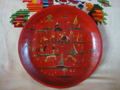 Mexican vintage folk art, and Mexican vintage woodcarvings and masks, a beautiful wood-carved batea with a red laquer background and colonial designs, Michoacan, c. 1930's.