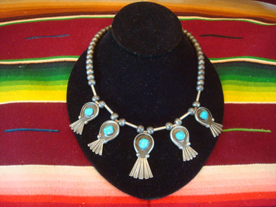Native American Indian vintage silver jewelry, and Navajo vintage sterling silver jewelry, a sterling silver necklace with five lovely squash-blossoms of silver and wonderful turquoise, Arizona or New Mexico, c. 1940's.