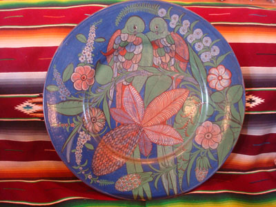 Mexican vintage pottery and ceramics, an incredibly lovely burnished pottery charger with exquisite, detailed artwork, Tonala, Jalisco, c. 1930's.