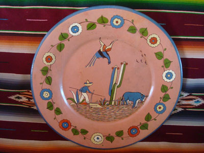 Mexican vintage pottery and ceramics, a large and very lovely pottery charger with a wonderful salmon-colored background and very fine artwork, Tonala or San Pedro Tlaquepaque, Jalisco, c. 1930's.