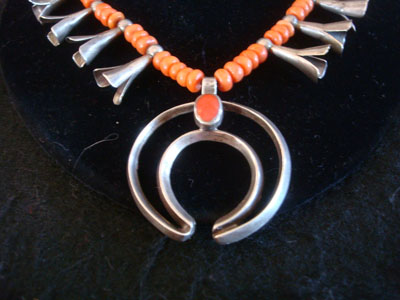 Native American Indian vintage sterling silver jewelry, and Navajo vintage silver jewelry, a beautiful silver necklace with stunning coral trade beads, silver hand-wrought bench beads, and a wonderful silver and coral naja, Navajo, Arizona or New Mexico, c. 1930's. The necklace is very beautiful in its simplicity and elegance. Closeup photo of the silver and corral naja.