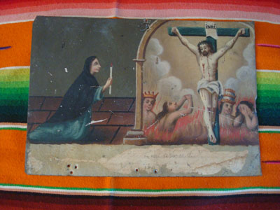 Mexican vintage devotional art, and vintage Mexican tinwork art, a beautifully painted exvoto, painted on tin, depicting Animas (souls in Purgatory) and a woman praying to the Crucified Christ on their behalf and that they be granted entrance to Heaven, Mexico, c. 1900.