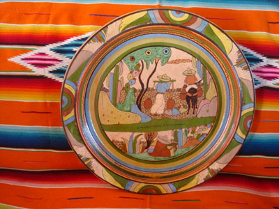 Mexican vintage pottery and ceramics, a beautiful pottery charger with lovely artwork and a wonderful petatillo background (a cross-hatching pattern resembling a straw mat or petate), Tonala or San Pedro Tlaquepaque, Jalisco, c. 1930's.