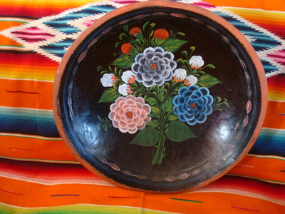 Mexican vintage folk art, and Mexican vintage woodcarvings and masks, a wonderful wood-carved batea or plate, with fantastice floral artwork, Quiroga, Michoacan, c. 1930's.