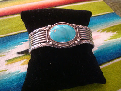 Native American Indian sterling silver jewelry, and Navajo silver jewelry, a very beautiful Navajo bracelet with exquisite silverwork and a wonderul turquoise stone (very possibly blue gem), Arizona or New Mexico, c. 1950's.