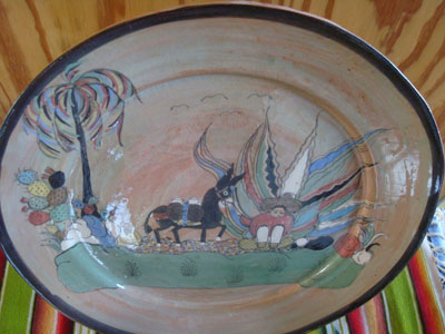Mexican vintage pottery and ceramics, a beautiful pottery charger with fine and very wonderful artwork, signed Santos Lucano (a nephew of the very famous Balbino Lucano), San Pedro Tlaquepaque, c. 2006.