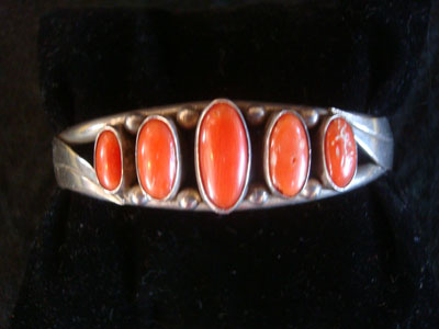 Native American Indian sterling silver jewelry, and Navajo vintage silver jewelry, a beautiful silver bracelet decorated with lovely coral, Navajo, Arizona or New Mexico, c. 1960's.