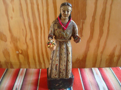 Mexican vintage devotional art, and Mexican vintage woodcarvings and masks, a wonderful wood-carved bulto (statue) depicting St. Elizabeth of Hungary, c. 1930.