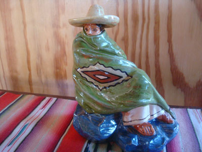 Mexican vintage folk art, and Mexican vintage pottery and ceramics, a lovely glazed statue of a Mexican gentleman relaxing and peering over the edge of his wonderful serape (sarape), Tonala or San Pedro Tlaquepaque, c. 1940.