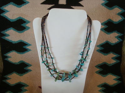 Native American Indian vintage jewelry, and Navajo vintage jewelry, a lovely three-strand necklace of turquoise and heishi, Arizona or New Mexico, c. 1950's.