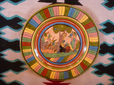 Mexican vintage pottery and ceramics, a beautiful petatillo (with a cross-hatching background resembling a straw mat, or petate, in Spanish) charger with very fine artwork and a colorful and very beautiful border, Tonala or San Pedro Tlaquepaque, c. 1940's.