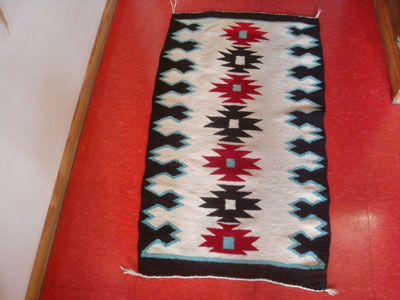 Native American Indian textiles, and Navajo vintage textiles and rugs, a wonderful Navajo rug with natural wools in cream and black, and aniline-dyed turquoise and red, Arizona or New Mexico, c. 1950's.