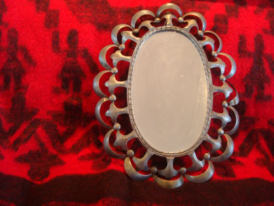 Mexican tinwork art, a lovely tinwork art mirror with tin scalloping all around it, c. 1930's.