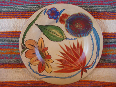 Mexican vintage pottery and ceramics, a very beautiful burnished charger with fine floral artwork against a lovely beige background, Tonala, Jalisco, c. 1930's.