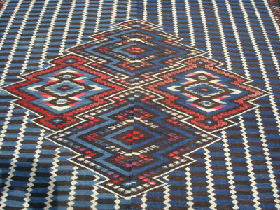 Mexican classic textiles and Saltillo serapes (sarapes), a beautiful classic Saltillo serape with an indigo blue background and yarns of black, white, red, and magenta, c. 1890. The weave is extremely fine and tight; this is a rare and very wonderful classic textile!