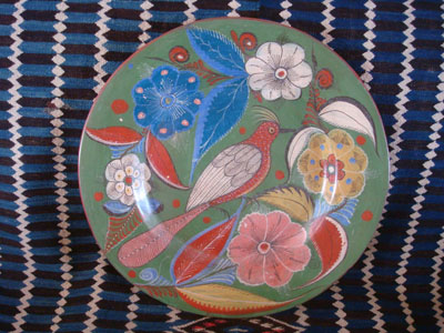 Mexican vintage pottery and ceramics, a beautiful burnished charger with an avocado- green background and phenomenal artwork featuring a wonderful floral decorations with a tropical bird in the center, Tonala or San Pedro Tlaquepaque, c. 1930's.