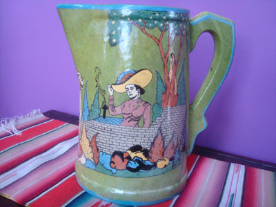 Mexican vintage pottery and ceramics, a very beautiful pottery pitcher with a wonderful apple-green background glaze and excellent artwork, San Pedro Tlaquepaque or Tonala, Jalisco, c. 1930's.