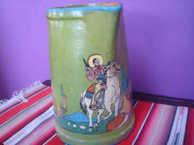 Mexican vintage pottery and ceramics, a very beautiful pottery pitcher with a wonderful apple-green background glaze and excellent artwork, San Pedro Tlaquepaque or Tonala, Jalisco, c. 1930's. The artwork features a dashing charro and his beautiful senorita. Picture of the caballero.