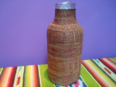 Native American Indian antique baskets, a Tlingit hand-blown glass bottle with wonderful weaving around it, c. 1900.