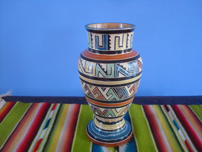 Mexican vintage pottery and ceramics, a lovely petatillo (background of fine cross-hatching resembling a straw mat, or petate, in Spanish), not signed but very possibly from the famous Lucano workshop, Tonala, c. 1930's.